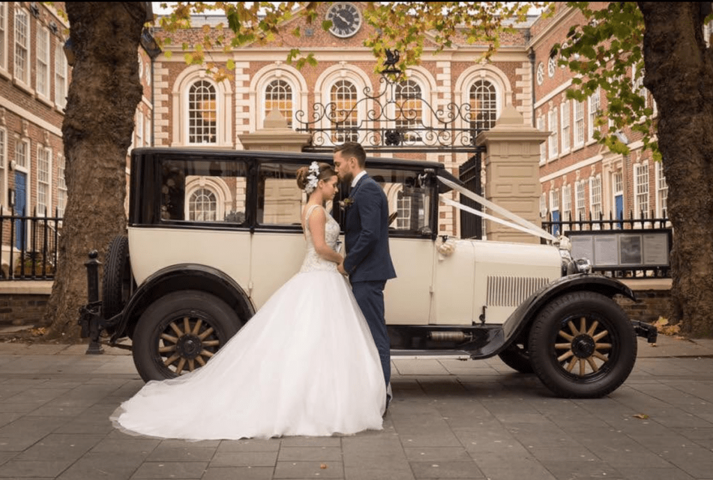 Bride and groom with wedding car outside Bluecoat Liverpool