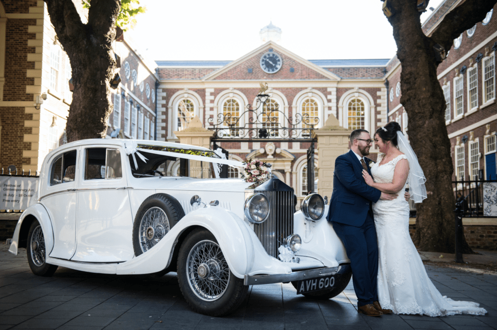 Bride and groom with car outside Bluecoat Liverpool wedding