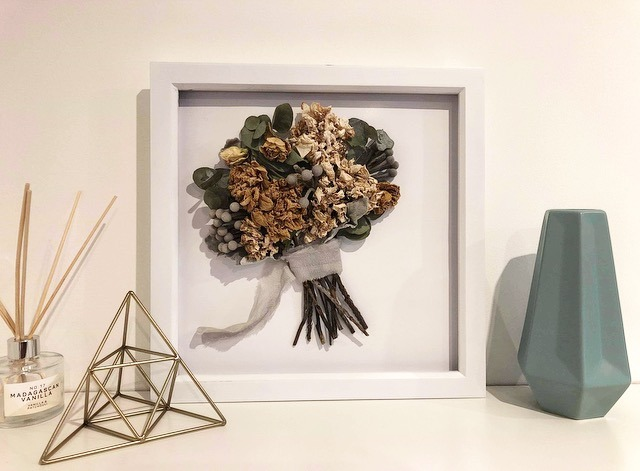 Preserved wedding bouquet on display in a frame